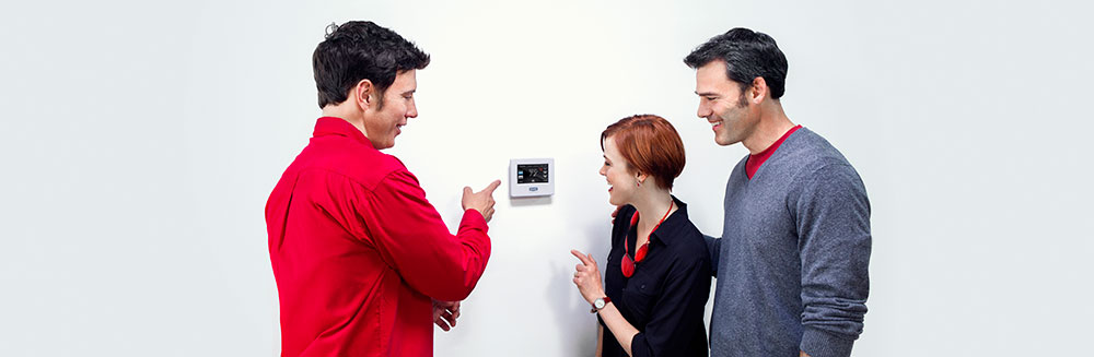 Thermostat controls explained by Bryant technician to homeowners