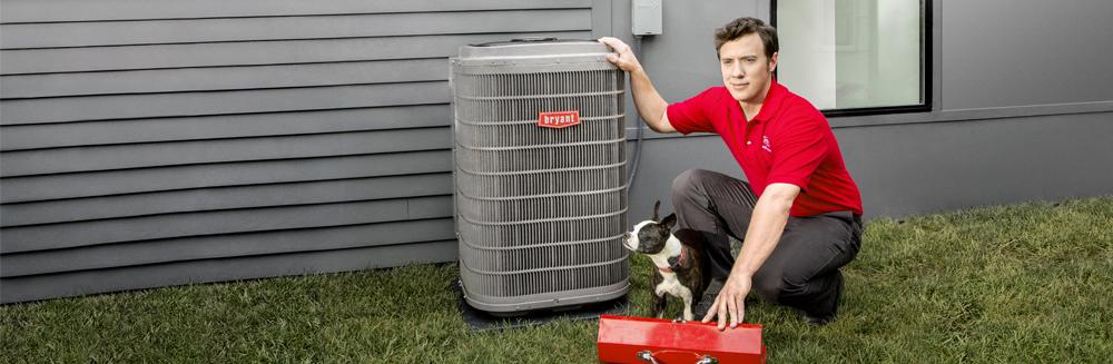 Bryant technician repairing air conditioner
