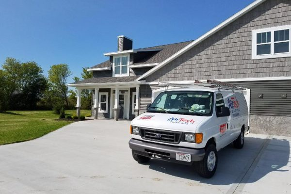 AirTech van parked outside of a recently constructed house
